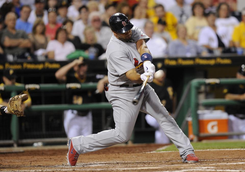 St. Louis Cardinals' Albert Pujols (5) hits a home run against the Pittsburgh Pirates during the sixth inning of a baseball game Tuesday, Aug. 16, 2011 in Pittsburgh. Pittsburgh won 5-4 in the eleventh inning.(AP Photo/Don Wright)