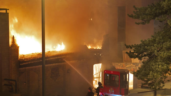 Firefighters are on the scene of a gas explosion and massive fire Tuesday night, Feb. 19, 2013 at JJ's restaurant at the Country Club Plaza in Kansas City, Mo. A car crashed into a gas main in the upscale Kansas City shopping district, sparking a massive blaze that engulfed an entire block and caused multiple injuries, police said. (AP Photo/The Kansas City Star, Tammy Ljungblad) KANSAS CITY OUT