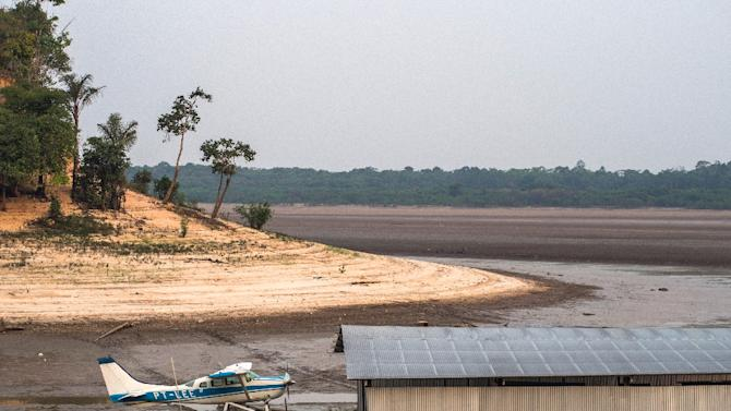 A stranded amphibious aircraft is seen next to a hangar on the bed of the Aleixo Lake, in the rural area of Manaus, Amazonas, Brazil, on October 23, 2015