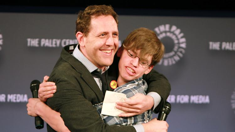 "Filmmaker Lee Hirsch left, embraces film subject Alex Libby at a special screening of ""Bully"" presented by The Weinstein Company and JP Morgan Chase and Company in partnership with Bing and Gucci, in New York on Tuesday, March 20, 2012. The film, directed by Hirsch, will be released in theaters on March 30. (AP Photo/StarPix, Dave Allocca)"