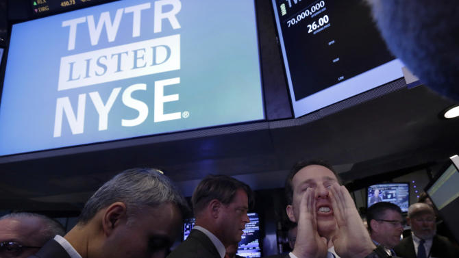 Specialist Glenn Carell calls out prices before Twitter begins trading during its IPO, on the floor of the New York Stock Exchange, Thursday, Nov. 7, 2013. If Twitter's bankers and executives were hoping for a surge on the day of the stock's public debut, they got it. The stock opened at $45.10 a share on its first day of trading, 73 percent above its initial offering price. (AP Photo/Richard Drew)