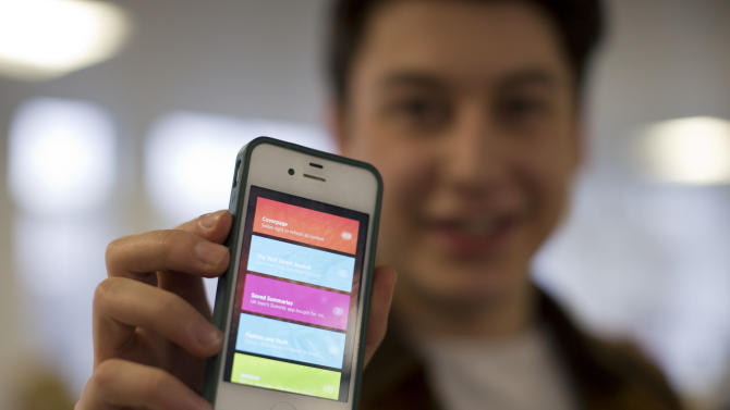 Nick d'Aloisio displays his mobile application Summly, as he poses for photographs after being interviewed by the Associated Press in London, Tuesday, March 26, 2013.  One of Britain's youngest Internet entrepreneurs has hit the jackpot after selling his top selling mobile application Summly to search giant Yahoo.  Seventeen year old Nick d'Aloisio, who dreamed up the idea for the content shortening program when he was studying for his exams, said he was surprised by the deal. As with its other recent acquisitions, Yahoo didn't disclose how much it is paying for Summly, although British newspapers suggested the deal's value at several million dollars.  (AP Photo/Matt Dunham)