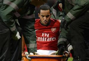 Arsenal's Walcott is stretchered off the pitch during their English FA Cup soccer match against Tottenham Hotspur at the Emirates stadium in London