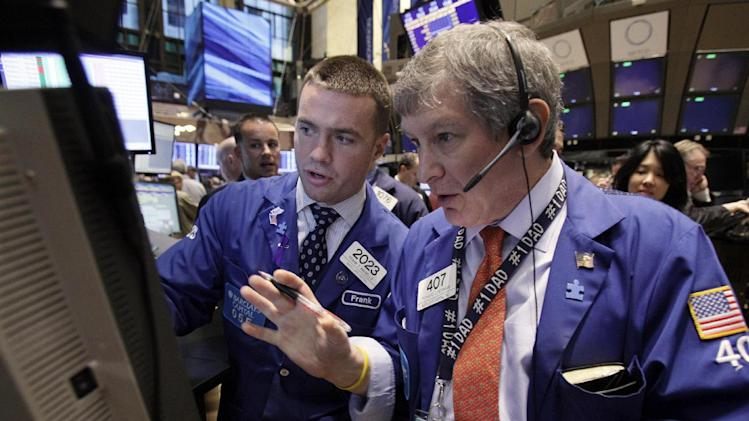 Specialist Frank Masiello, left, and trader Richard Newman work on the floor of the New York Stock Exchange Thursday, Nov. 3, 2011. Stocks rose in early trading Thursday as hopes grow that a plan to tackle the European debt crisis will survive. (AP Photo/Richard Drew)