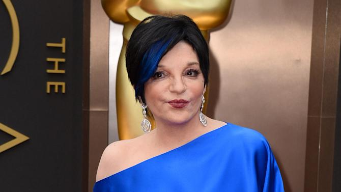 FILE - In this March 2, 2014 file photo, Liza Minnelli arrives at the Oscars in Los Angeles. Minnelli is said to be resting comfortably in a California hospital after undergoing back surgery this week and she's thanking fans for their well wishes. Minnelli's back injury had prevented her from performing most of the year or attending the funeral of Joan Rivers in New York this month. (Photo by Jordan Strauss/Invision/AP)
