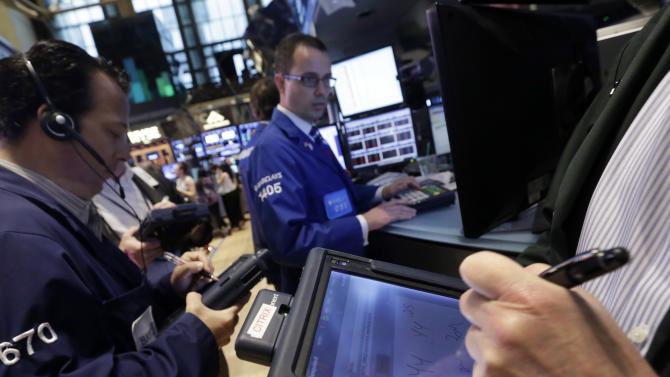 In this Friday, May 31, 2013, photo, traders use their handheld devices as they work  on the floor of the New York Stock Exchange. Uncertainty about the U.S. Federal Reserve's next course of action and a sharp, sudden plunge on Wall Street sent global stock markets lower Monday June 3, 2013. (AP Photo/Richard Drew)
