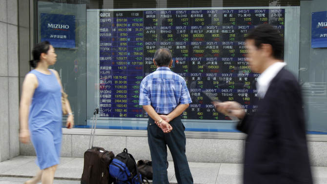 A man looks at an electronic stock board of a securities firm in Tokyo, Monday, Sept. 5, 2011. Asia-Pacific stocks took a beating early Monday after jobs data out of the U.S. last week revived fears of a recession in the world's largest economy. (AP Photo/Koji Sasahara)