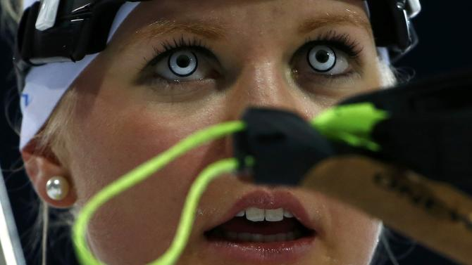 Estonia's Gaim reacts after crossing the finish line during the women's biathlon 7.5km sprint event at the Sochi 2014 Winter Olympics in Rosa Khutor