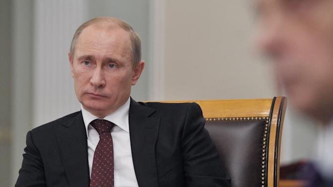 Russian President Vladimir Putin chairs a meeting on health care in the Novo-Ogaryovo outside Moscow, Wednesday, Oct. 31, 2012. (AP Photo/RIA-Novosti, Alexei Nikolsky, Presidential Press Service)
