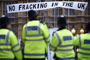 British police watch an anti-shale gas and fracking …