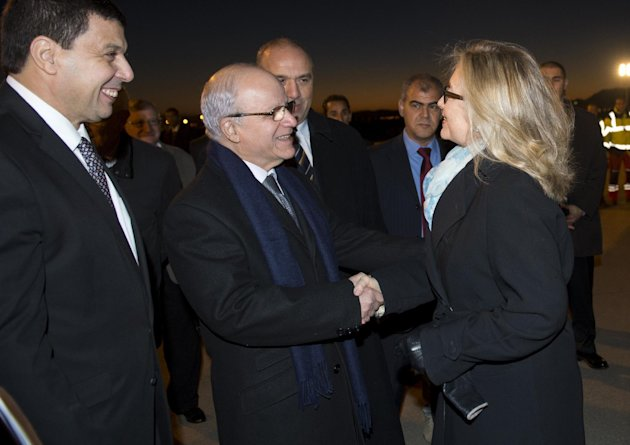 Algerian Foreign Minister Mourad Medelci, centre, greets US Secretary of State Hillary Rodham Clinton, upon her arrival at Houari Boumediene Airport, in Algiers, Algeria, Monday, Oct. 29, 2012. US Secretary Secretary of State Hillary Rodham Clinton is on a five-day trip overseas to increase pressure on Mali&#39;s al-Qaida-linked rebels and help Balkan nations end long-simmering ethnic and political disagreements. (AP Photo, Saul Loeb, Pool)
