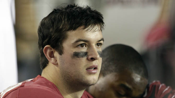 Alabama quarterback AJ McCarron (10) watches from the sidelines during the second half of an NCAA college football game against Texas A&M at Bryant-Denny Stadium in Tuscaloosa, Ala., Saturday, Nov. 10, 2012. Texas A&M won 29-24. (AP Photo/Dave Martin)