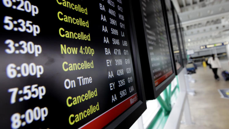 A flight information screen displays of cancellation for flights at O'Hare International Airport in Chicago, Tuesday, March 5, 2013. A late-winter storm barreled through the Midwest, snarling air travel in and out of Chicago, and it will soon take aim at busy airports around Washington, D.C. (AP Photo/Nam Y. Huh)
