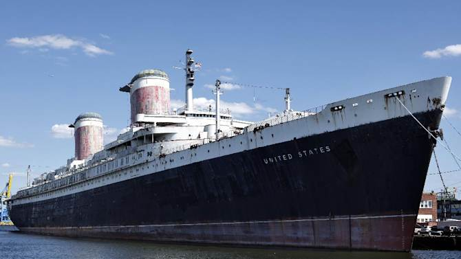 FILE - In this July 1, 2010 file photo show is the SS United States in Philadelphia. Money and time are running out for the historic ocean liner, which carried princes and presidents across the Atlantic in the 1950s and 1960s but has spent decades patiently awaiting a savior at its berth on the Philadelphia waterfront. The nonprofit conservancy working to secure a home and purpose for the 990-foot-long ship said it could be sold for scrap in the spring of 2013 unless they can raise $500,000 immediately.  (AP Photo/Matt Rourke, File)