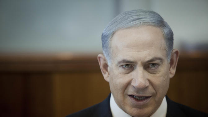 FILE - In this file photo taken Sunday, Nov. 17, 2013, Israel's Prime Minister Benjamin Netanyahu attends a weekly cabinet meeting in Jerusalem. Fresh off a series of scandals over his high-flying lifestyle and expensive habits, the prime minister said Monday, Dec. 9, that he will skip Nelson Mandela's funeral due to the high cost of the trip. (AP Photo/Dan Balilty, File, Pool)