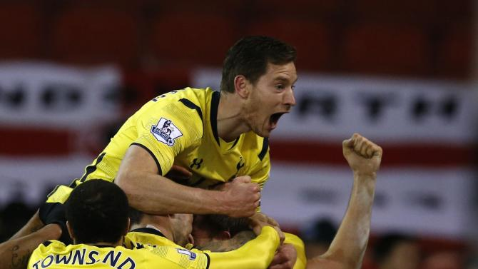Tottenham Hotspur's Stambouli celebrates Eriksen's goal against Sheffield United during their Capital One Cup semi final second leg soccer match at Bramall Lane in Sheffield