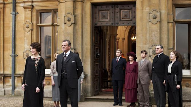 "This undated publicity photo provided by PBS shows, from left, Elizabeth McGovern as Lady Grantham, Hugh Bonneville as Lord Grantham, Dan Stevens as Matthew Crawley, Penelope Wilton as Isobel Crawley, Allen Leech as Tom Branson, Jim Carter as Mr. Carson, and Phyllis Logan as Mrs. Hughes, from the TV series, ""Downton Abbey.""  Producers of the popular British period drama on Thursday, March 26, 2015, confirmed it will end after its sixth season, scheduled to air in the U.S. in early 2016. The series, which airs earlier in England, will have its finale on Christmas Day, 2015. (AP Photo/PBS, Carnival Film & Television Limited 2012 for MASTERPIECE, Nick Briggs)"