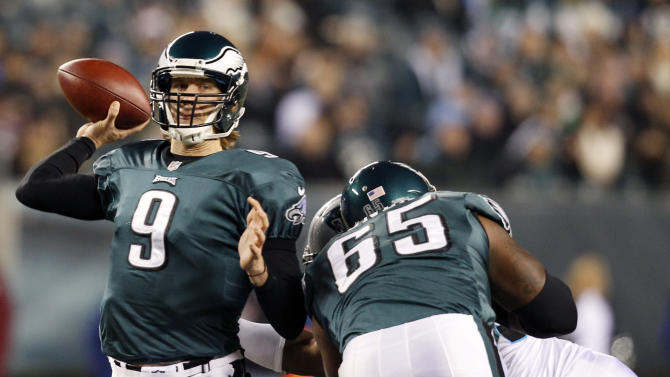 Philadelphia Eagles quarterback Nick Foles passes in the first half of an NFL football game against the Carolina Panthers, Monday, Nov. 26, 2012, in Philadelphia. (AP Photo/Mel Evans)