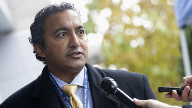 FILE - In this Nov. 13, 2012 file photo, then-Rep.-elect Ami Bera, D-Calif., speaks to reporters after he registered for orientation at a hotel as newly-elected members of Congress arrived on Capitol Hill in Washington. Democratic Rep. Tulsi Gabbard, of Hawaii, is the first Hindu elected to Congress. Bera, also a Democrat, is the third Indian-American to serve in the House. Gabbard, however, isn't from India, where Hinduism originated and the background shared by the vast majority of its adherents have ethnic ties.  (AP Photo/Charles Dharapak, File)