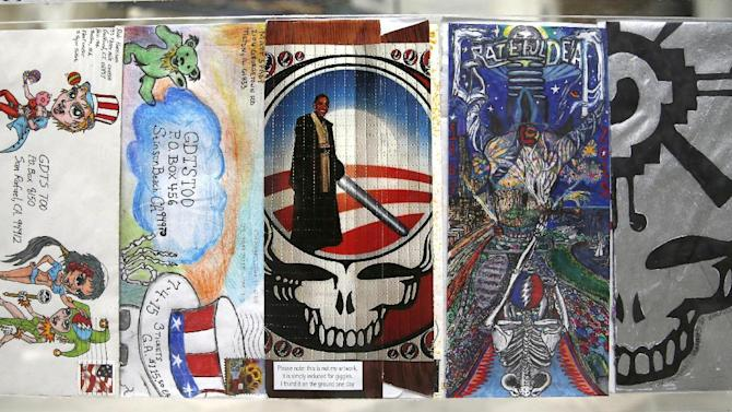 In this Tuesday, June 30, 2015, photo, various decorative mailing envelopes sent to the Grateful Dead's ticketing agent, by a fans seeking to purchase tickets to a future concert, are displayed as part of a Grateful Dead exhibit at the Field Museum in Chicago. The Dead are scheduled to perform multiple shows over the July 4th weekend at Soldier Field.(AP Photo/Charles Rex Arbogast)