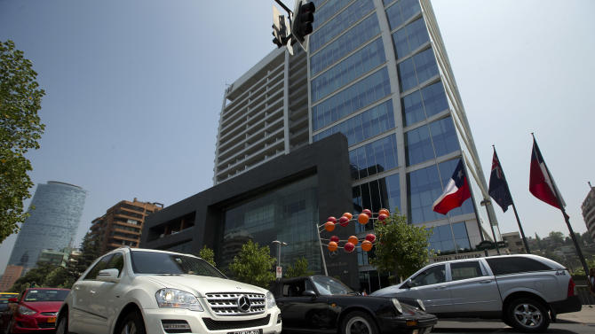 """Luxury cars drive past a five-star hotel in the financial district of Santiago, Chile, Thursday, Jan. 24, 2013. European, Latin American and Caribbean leaders gathering for this weekend's economic summit will likely see only one side of Chile _ the polished, upscale country where tourists and investors stay in five-star hotels in a sparklingly clean financial district nicknamed """"Sanhattan,"""" well away from Santiago's slums. (AP Photo/Victor R. Caivano)"""