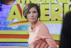 Amanda Knox prepares to leave the set following a television …