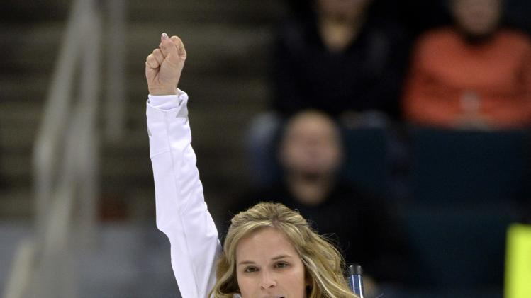 Skip Jennifer Jones reacts after scoring three in the fourth end against Team Nedohin during draw 12 at the Roar of the Rings Canadian Olympic Curling Trials in Winnipeg