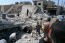 Syrians look for survivors amongst the rubble in the town of Qusayr, in the central Homs province, on May 21, 2013