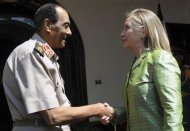 Egyptian military chief Field Marshal Mohamed Hussein Tantawi (L) shakes hand with U.S. Secretary of State Hillary Clinton before their meeting at the Defence Ministry in Cairo July 15, 2012. Hundreds of people chanted anti-U.S. and anti-Islamist slogans outside Clinton's hotel on Saturday as the U.S. secretary of state urged Egypt's military and Muslim Brotherhood to complete a transition to full democratic rule. REUTERS/U.S Embassy Media Office/Handout