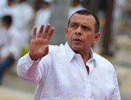 Honduras' President Porfiro Lobo waves upon his arrival at the Summit of the Americas in Cartagena, Colombia. Leaders from across the Americas launched talks Saturday on expanding trade but were split on alternatives to the failing war on illegal drug trafficking, and on relations with Cuba