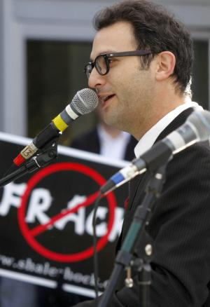 FILE - In this file photo from Nov. 3, 2010, documentary filmmaker Josh Fox speaks at a rally of protestors against Marcellus Shale drilling and hydraulic fracturing in Pittsburgh. Researchers say the claim that fracking has been linked to increased cancer rates in Texas is simply wrong. Fox, an Oscar-nominated filmmaker who uses the claim in a new film, declined to acknowledge the error when told of researchers who say he's doing a disservice to people with cancer by misrepresenting health data. (AP Photo/Keith Srakocic, File)