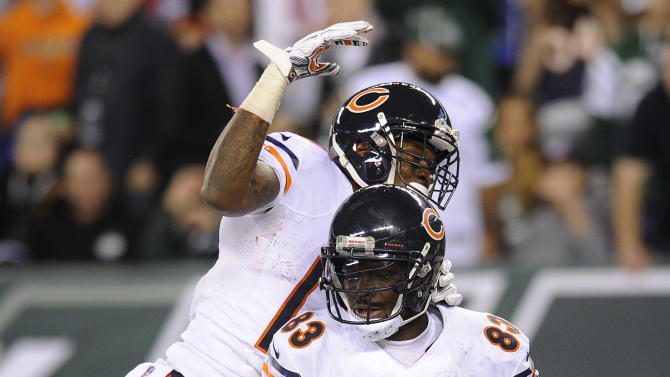 Chicago Bears tight end Martellus Bennett (83) celebrates with wide receiver Alshon Jeffery (17) after scoring a touchdown against New York Jets in the third quarter of an NFL football game, Monday, Sept. 22, 2014, in East Rutherford, N.J
