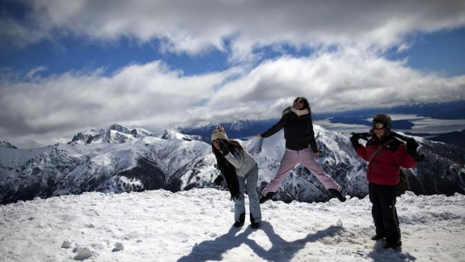 Tourists play on a mountain in San Carlos de Bariloche, Argentina, Friday, Sept. 21, 2012. Thousands of Argentines began enjoying Friday  to make the most of the long weekend, which lawmakers approved just three weeks ago. Monday's Sept. 24th holiday makes for a total of 19 national paid holidays this year. Only Colombia comes close in Latin America, with 18. (AP Photo/Natacha Pisarenko)