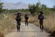 Israeli soldiers patrols near the border between the Golan Heights and Syria near the village of Buqaataon. Syria&#39;s minimum condition for any peace deal has always been the return of the strategic Golan Heights, which Israel occupied in the 1967 Six-Day War and annexed in 1981