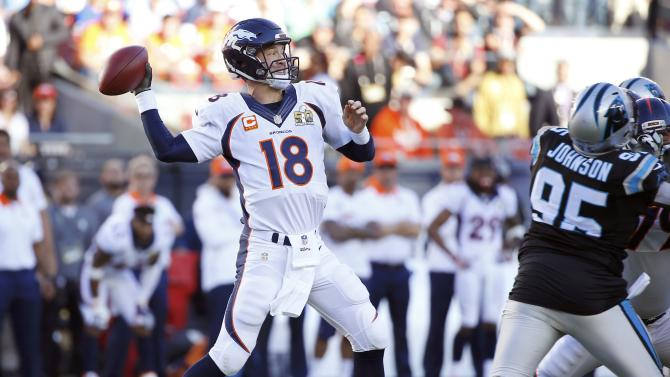 Denver Broncos' quarterback Peyton Manning throws a pass against the Carolina Panthers during the first quarter of the NFL's Super Bowl 50 football game in Santa Clara