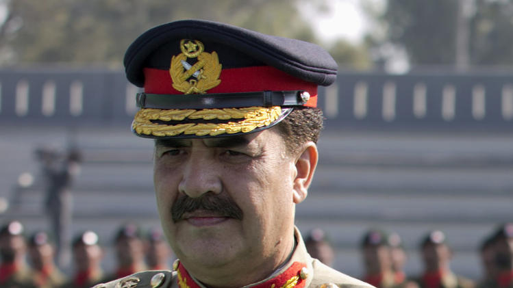 FILE - In this Friday, Nov, 29, 2013 file photo, Pakistan's army chief Gen. Raheel Sharif listens to the national anthem in Rawalpindi, Pakistan. Prime Minister Nawaz Sharif on Friday denied asking the military chief to mediate with opposition leaders and protesters who have camped for two weeks outside parliament in the capital, Islamabad, demanding his resignation over alleged voting fraud. (AP Photo/B.K. Bangash, File)