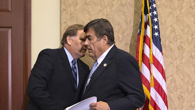 """House Intelligence Committee Chairman Rep. Mike Rogers, R-Mich., left, and huddles with the committee's ranking Democrat, Rep. C.A. """"Dutch"""" Ruppersberger, D-Md., on Capitol Hill in Washington, Monday, Oct. 8, 2012, during a news conference to release a report on a yearlong probe of China's two leading technology firms, Huawei Technologies Ltd. and ZTE Corp., warning they pose a major security threat to the US. (AP Photo/J. Scott Applewhite)"""