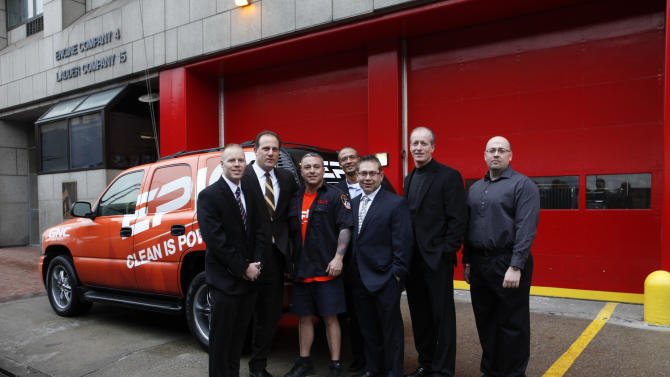 IMAGE DISTRIBUTED FOR EPIQ - Kristofer Soder, Vice President of GNC Vincent Cacace, FDNY fireman Al Spinelli, Director of Brand Management Sports Nutrition for EPIQ Brent Coward, Dino Lopez, Al Masson and Eric Hesse donate gym equipment to FDNY Engine 4, Ladder 15 at EPIQ Thank You In Relief of Sandy on Tuesday, Feb. 5, 2013 in New York City. (Photo by Amy Sussman/Invision for EPIQ/AP Images)