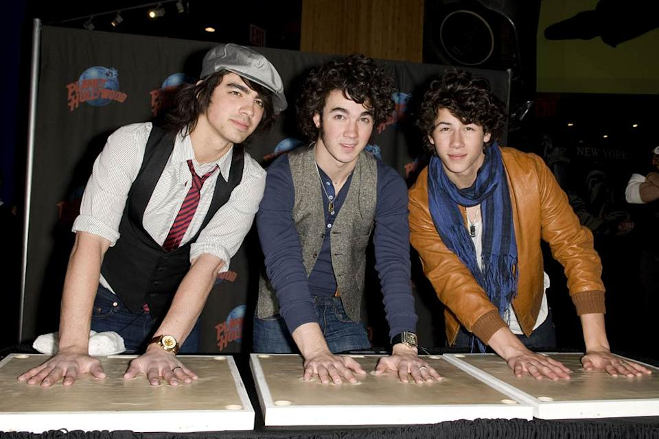 Nick, Kevin, and Joe Jonas attend the Jonas Brothers Handprint Ceremony at Plant Hollywood on March 22, 2008 in New York City.