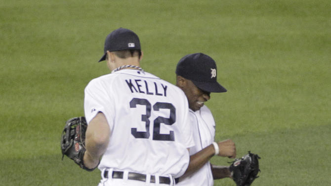 Detroit Tigers center fielder Austin Jackson, right, and teammate third baseman Don Kelly celebrate their 5-2 win over the Texas Rangers in Game 3 of baseball's American League championship series Tuesday, Oct. 11, 2011, in Detroit. (AP Photo/Duane Burleson)