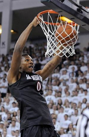 No. 7 San Diego St holds off Utah St 74-69 in OT