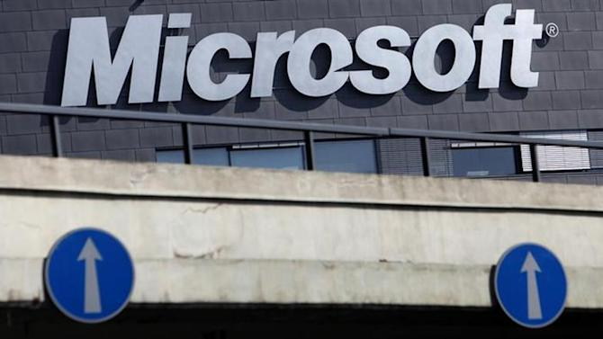 The Microsoft logo is seen on the wall of the company's branch in Prague March 17, 2013. REUTERS/David W Cerny/Files