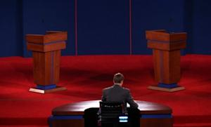 University of Denver student Sam Garry sits at the moderator's desk before a presidential debate dress rehearsal on Oct. 2: The debate will air tonight on all the major networks, and is available for viewing online.
