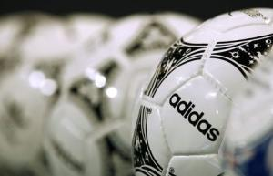 Footballs from Adidas, world's second largest sports apparel firm, are displayed before company annual general meeting in Fuerth