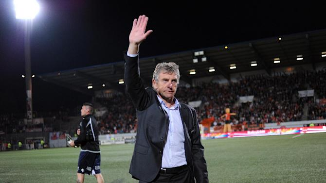 Lorient's French head coach Christian Gourcuff thanks the supporters after the French L1 football match between Lorient and Lille on May 17, 2014