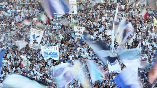 Lazio supporters wave flags (Reuters)