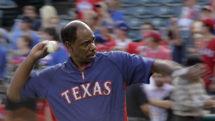 Texas Rangers manager Ron Washington throws before Game 4 of baseball's World Series against the St. Louis Cardinals Sunday, Oct. 23, 2011, in Arlington, Texas. (AP Photo/Charlie Riedel)