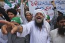 Supporters of the religious political party Markazi Jamiat Ahlehadith Pakistan shout slogans during protest against anti-Islam film made in the U.S. mocking Prophet Mohammad, in Karachi