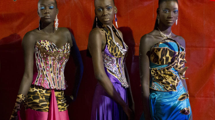 Models wearing designs by Habib Sangare of Ivory Coast wait backstage to walk the runway at Hotel des Almadies, in Dakar, Senegal, on Saturday, June 22, 2013. After a Friday show held in a dusty marketplace in the working class suburb of Guediawaye, the runway finale of Dakar Fashion Week was held at a luxury hotel and showcased the work of 14 designers from West Africa, Europe, South America, and the Caribbean. (AP Photo/Rebecca Blackwell)