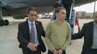 "<p>Luka Rocco Magnotta (C) is escorted by police upon arrival June 18, 2012 at Mirabel Airport outside Montreal, Canada. Magnotta, dubbed ""the Canadian Psycho"", is accused of slaying and dismembering a Chinese student in Montreal, before fleeing to Europe.</p>"